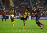 Wan Zack Haikal (25) takes on Neymar