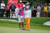 Na Yeon Choi takes advise from caddy.