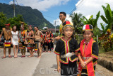 Villagers come out to join the procession