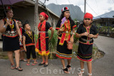 Villagers come out to greet the procession
