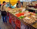 A fish vendor at the Venice Seafood Market