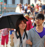 Happy tourists in the San Marco Square. Open your umbrella against the hot sunny day!