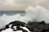 Surf crashing on the rocks behind the Pouch Cove Town Hall