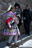 A Quechua Woman with a Baby Goat
