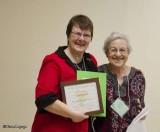 Angela Skevington receiving the Mary Stuart Education Award from Fenja