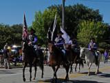Both horses eye the camera