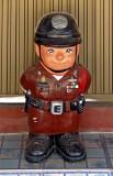 Small plaster cop