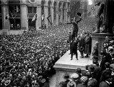 1918 - Charlie Chaplin held aloft by Douglas Fairbanks