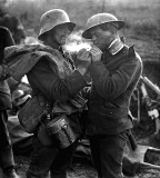German giving British prisoner a light