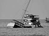 Sinking boat with help on the way