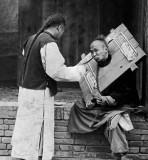 1902 - Feeding a prisoner in a cangue