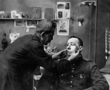 Soldier with mutilated face being fitted with a mask
