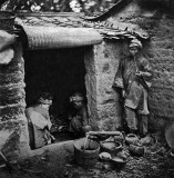 1873 - Beggars living in a tomb