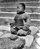 c. 1918 - Baby put on the street to beg