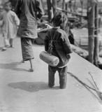 c. 1918 - Girl wearing life preserver