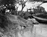 c. 1918 - Launching boat by mud slide