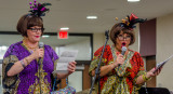 Crayola and Minneola flip a coin for the bead contest