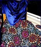 Satin blouse and rose window circular skirt.
