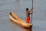 A boy in a boat on the River Manambolo