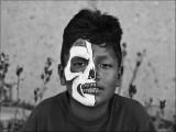 Boy with painted mask