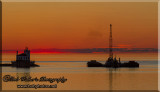 Oswego, New York's Lighthouse With  Dredging Barge