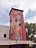 Close-up of feed mill tower decorated by local artists