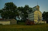 Skiddy, KS old grain elevator after sunset.