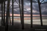 Early Dawn Breaking Under Pier