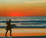 kiteboarder at sunset