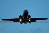 2013 - Lear Jet on short final approach after sunset corporate aviation stock photo