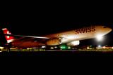 2013 - Swiss A330-343X HB-JHN flight #65 to Zurich night takeoff aviation stock photo