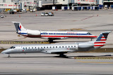 2014 - the new and old American Eagle paint schemes on ERJ-145LR N925AE and ERJ-135KL N801AE aviation aircraft stock photo #3261