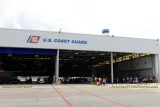 Coast Guard Day Picnic attendees dining on a variety of goodies inside the fixed-wing hangar at Air Station Miami