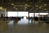 2014 Coast Guard Day Picnic attendees dining on a variety of foods in the fixed-wing hangar at Air Station Miami