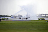 2014 - JetBlue A320-232 N709JB taxiing through the water cannon salute after being the first flight to land on 10R