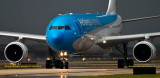 Aerolineas Argentinas Airbus A330-223 LV-FNJ taxiing in after landing on runway 27 before a storm aviation airline stock photo