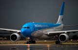 Aerolineas Argentinas Airbus A330-223 LV-FNJ taxiing in after landing on runway 27 before a storm aviation airline stock phot