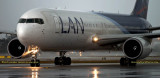 LAN Airlines B767-316ER CC-CXI taxiing in after landing on runway 27 before a storm aviation airline stock photo