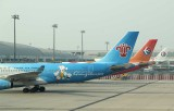 Tails of 3 A-330s belonging to China Southern and China Eastern with special liveries
