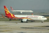 Hainan Airlines 737-800 taxi at PEK with a Turkish B-777-300 in the background