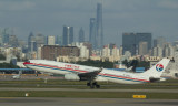 MU A-330 taking off with Shanghai skyline as the background, Nov 1 2016