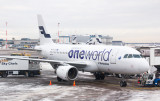 Finnair A-320 in OneWorld livery at a snowy HEL