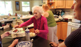 March 2013 - Grandma serving out slices of her 92nd birthday cake to guests at Wendy and Jim's in St. Petersburg