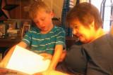 July 2012 - Kyler reading a book to grandma Karen