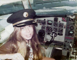 1974 - Debbie Cicirelli, National Airlines Flight Attendant, in the captain's seat of a National B727
