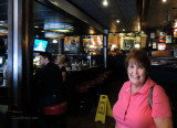 July 2014 - Karen at the spot inside Friday's at The Falls where we met 33 years before on July 3, 1981