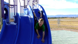 October 2014 - Kyler on the playground slide at Peterson Air Force Base
