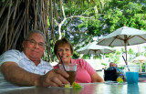 August 2010 - Don and Karen Boyd having some potent drinks at the outside bar of the military's Hale Koa Hotel on Waikiki Beach