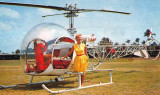1950's - Ellen M. Gilmore, owner and pilot, posing with a Sky Lark Bell 47 helicopter at Watson Island