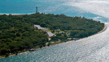 October 2015 - closeup aerial photo of Cape Florida Lighthouse at Bill Baggs State Park on Key Biscayne
